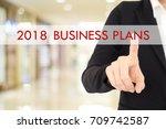 businesswoman hand touching... | Shutterstock . vector #709742587