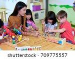 teachers and children  having... | Shutterstock . vector #709775557