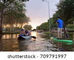 traffic on flooded roads in... | Shutterstock . vector #709791997