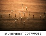 a small network developing in... | Shutterstock . vector #709799053