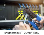 male hand preparing a lan cable. | Shutterstock . vector #709844857
