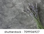 bouquet of lavender on a gray... | Shutterstock . vector #709936927