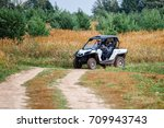 young people on quad bikes on a ... | Shutterstock . vector #709943743