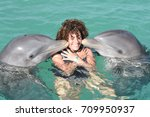 woman kissing by two dolphins...   Shutterstock . vector #709950937