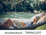 stylish hipster woman relaxing... | Shutterstock . vector #709961197