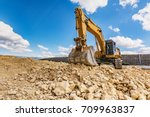 Small photo of Large excavator worked on a site