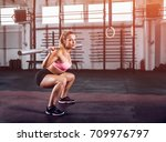 muscular girl doing squats with ... | Shutterstock . vector #709976797