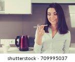 portrait of a happy woman using ... | Shutterstock . vector #709995037