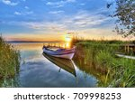 sunset in the lake | Shutterstock . vector #709998253