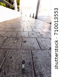 Small photo of Adhesive bandage spread on the pavement.