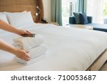 hands of hotel maid  bringing... | Shutterstock . vector #710053687