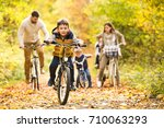 young family in warm clothes... | Shutterstock . vector #710063293