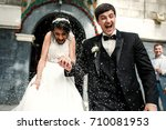 friends throw rice on newlyweds ... | Shutterstock . vector #710081953