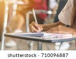 school student's taking exam... | Shutterstock . vector #710096887