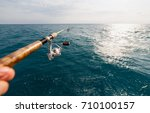 fisherman fishing rod on the... | Shutterstock . vector #710100157