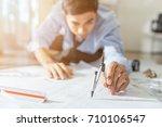 architect working on blueprint... | Shutterstock . vector #710106547