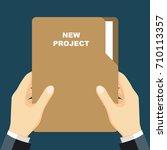 hand holding folder  folder... | Shutterstock .eps vector #710113357