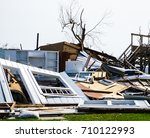 house destruction from powerful ... | Shutterstock . vector #710122993