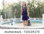 children play with water in the ... | Shutterstock . vector #710135173