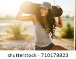 smiling woman holding... | Shutterstock . vector #710178823