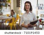 portrait of smiling waitress... | Shutterstock . vector #710191453