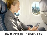 woman using smartphone in... | Shutterstock . vector #710207653
