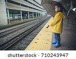 boy with an umbrella stands on... | Shutterstock . vector #710243947