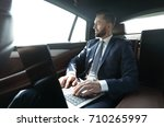 smiling businessman with laptop ... | Shutterstock . vector #710265997