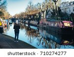 view of houseboats in a channel ... | Shutterstock . vector #710274277