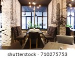 cozy dining place at window ... | Shutterstock . vector #710275753