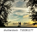 silhouette couple holding hand... | Shutterstock . vector #710281177