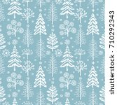 Winter seamless Christmas pattern for design packaging paper, postcard, textiles. The pattern with the image of fir-trees, trees, bushes covered with snow | Shutterstock vector #710292343