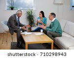 financial adviser talking to... | Shutterstock . vector #710298943