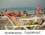 girl in a hat lies in a... | Shutterstock . vector #710299147