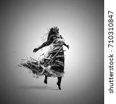 a woman is full of broken wood... | Shutterstock . vector #710310847