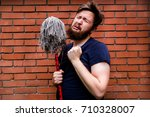 Small photo of the sad man with a broom