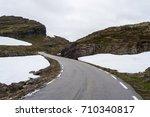 mountain road in norway runs...   Shutterstock . vector #710340817