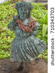 Small photo of Honolulu, Hawaii, USA, Sept. 6, 2017: Hula statue of a young girl with dried flowers at the new Aloha Tower Market.