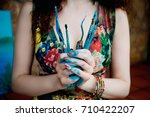 the artist holds the paint...   Shutterstock . vector #710422207