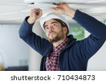 contractor fitting ceiling vent | Shutterstock . vector #710434873