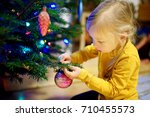 adorable little girl decorating ... | Shutterstock . vector #710455573