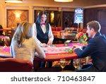 cute lady casino dealer at... | Shutterstock . vector #710463847