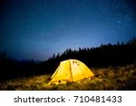 glowing camping tent in the... | Shutterstock . vector #710481433