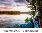 summer camping by the lake....   Shutterstock . vector #710483203