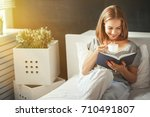happy young woman reads book... | Shutterstock . vector #710491807