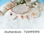 miniature people  sandy beach... | Shutterstock . vector #710495593