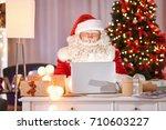 authentic santa claus using... | Shutterstock . vector #710603227