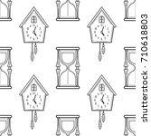 hourglass and cuckoo clock.... | Shutterstock .eps vector #710618803