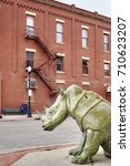 Small photo of Sheridan, USA - October 30, 2016: Bronze rhino on a pavement. This sculpture called The Boss was created by Dollores B. Shelledy and donated by the Sheridan Public Arts Committee in 2006.