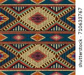Embroidered seamless geometric pattern. Ornament for the carpet. Ethnic and tribal motifs. Colorful print of handmade. Vector illustration. | Shutterstock vector #710633767